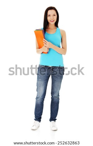 Young student woman standing with her notes. - stock photo