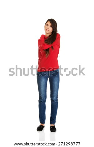 Young student woman suffering from back pain. - stock photo