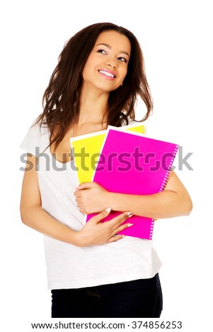 Young student woman with notes. - stock photo