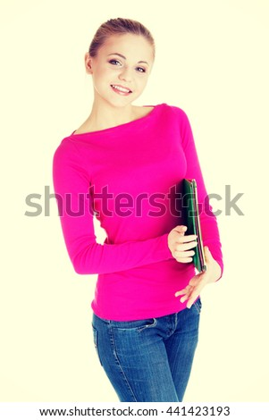 Young student woman with workbook. - stock photo