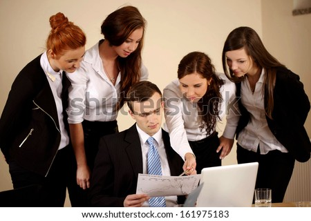 Young students analyzing the diagram in the office - stock photo