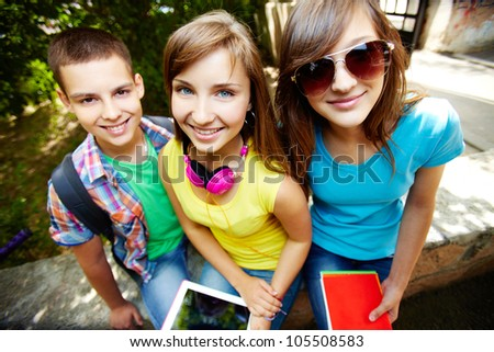 Young students enjoying themselves in the open air - stock photo