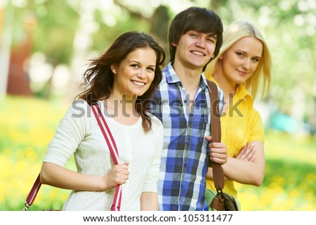 young students group of three people in spring outdoors - stock photo