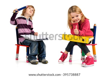 Young students seated in a chair isolated in white - stock photo