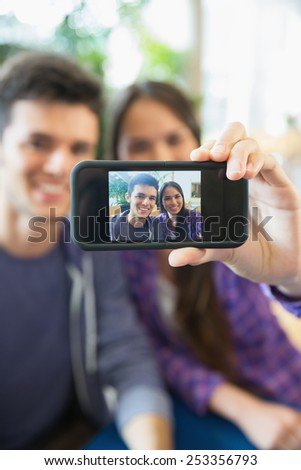 Young students taking a selfie at the university - stock photo