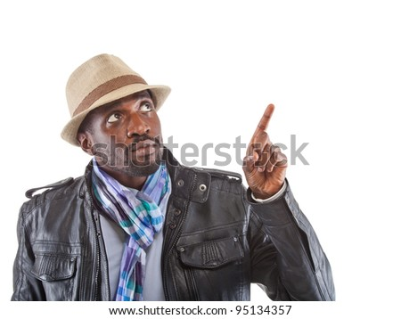 Young stylish black man pointing with his finger. - stock photo