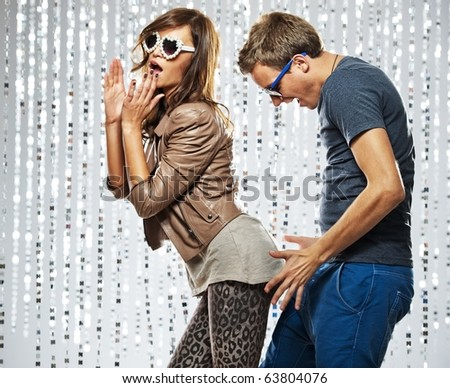 Young stylish couple flirting in the nightclub - stock photo