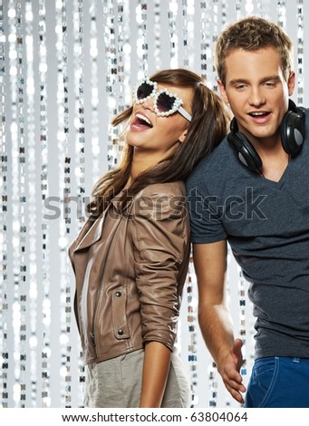 Young stylish couple in the nightclub - stock photo