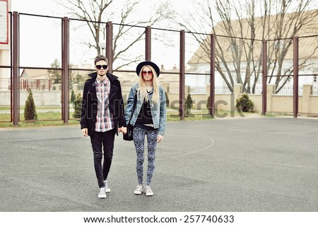 Young stylish couple outdoor fashion portrait  - stock photo
