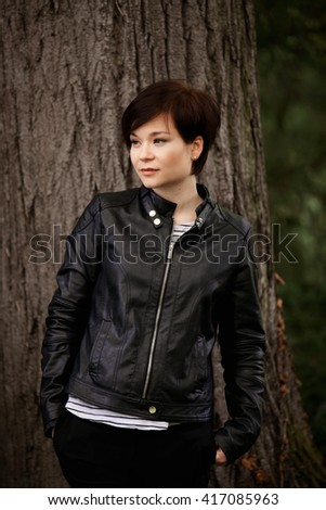Young stylish girl in the park - stock photo