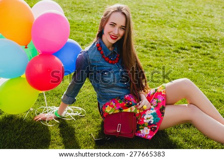 young stylish hipster outfit teen girl happy smiling, park, air balloons birthday party, cool accessories, red lipstick makeup, colorful, sunny, have fun, sitting on grass, denim shirt, braces, sunny - stock photo