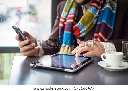 young stylish man lifestyle at the bar in the city - stock photo
