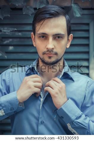 Young stylish man model portrait posing. Fashion shot.  man model sunglasses, man model casual, man model vogue, man model pose, man handsome, man model sexy, man model shirt, man pose, man style - stock photo