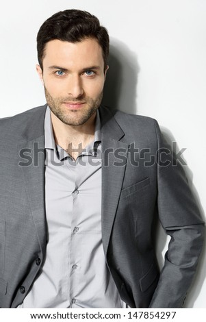 Young stylish man on a gray background - stock photo