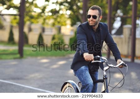 Young stylish man with retro bike - stock photo