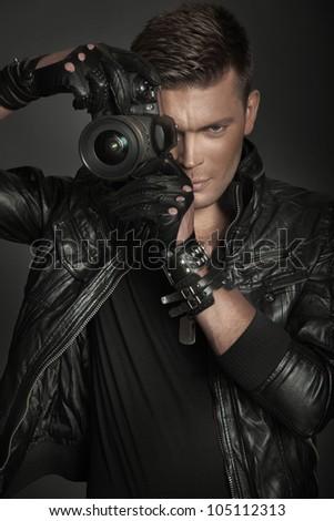 Young stylish photographer - stock photo