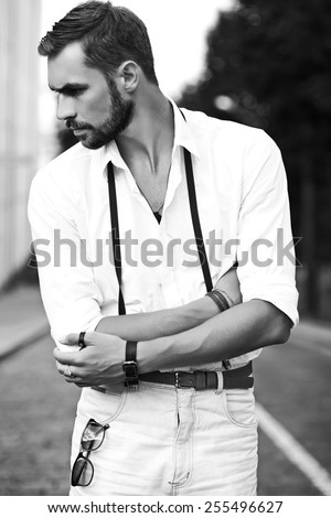 Young stylish sexy handsome model man in casual cloth lifestyle in the street  - stock photo