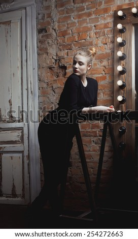 young stylish woman in make up room with mirror, diva actress before perfomance - stock photo