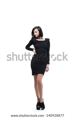 Young stylish woman wearing black dress and heels. - stock photo