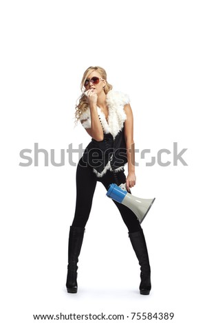 Young stylish woman with megaphone - stock photo