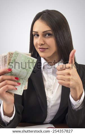 Young succesfull businesswoman with money - stock photo