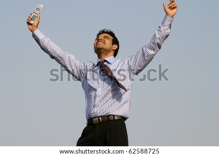 Young successful business man happy getting a contract over mobile - stock photo