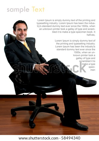 Young successful business man sitting at his office with copy space - stock photo