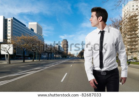 Young successful business man walking in business center - stock photo