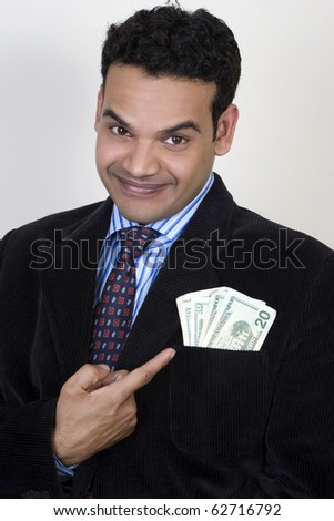 Young successful business man with money in his pocket - stock photo