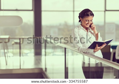 Young successful business woman speaking on a mobile phone - stock photo