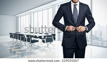 Young successful businessman in contemporary office - stock photo