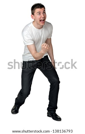 Young successful businessman with very positive facial expression and body language that says: - in the end he succeeded! - stock photo