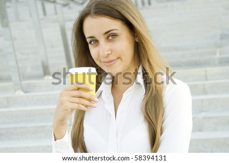 Young successful businesswoman having a coffebreak - stock photo