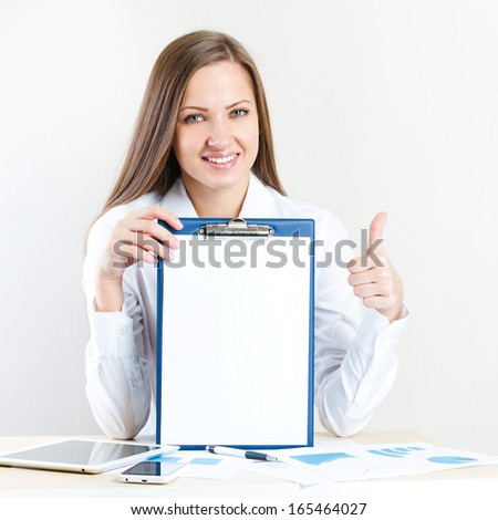 Young successful businesswoman wearing casual shirt at office - stock photo