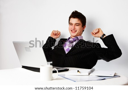 young successful confident man with laptop, triumph - stock photo