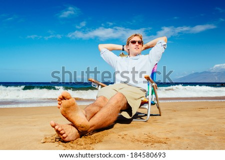 Young Successful Entrepreneur Businessman Relaxing on the Beach - stock photo