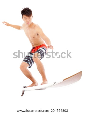 young surfer practice surfing pose  - stock photo