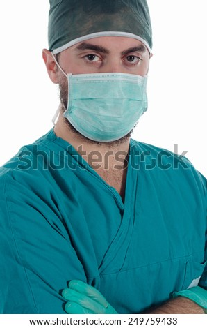 Young surgeon with mask and gloves - stock photo