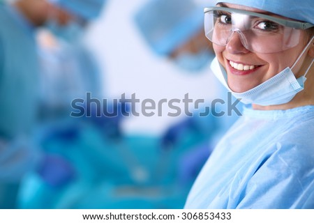 Young surgery team in the operating room - stock photo