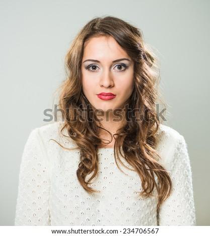 young surprised caucasian brunet woman portrait - stock photo
