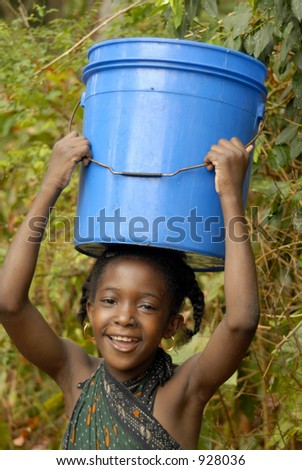 Young Swahili girl carrying rain water on Chole Mjini Island near Zanzibar Island, Tanzania - stock photo