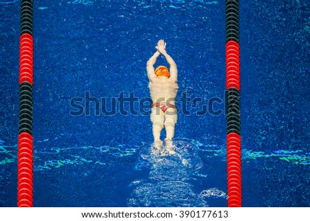 Young Swimmer warming up in the pool - stock photo