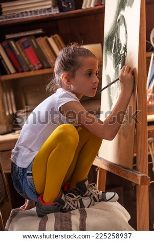 Young talented girl artist .Charcoal drawings. - stock photo