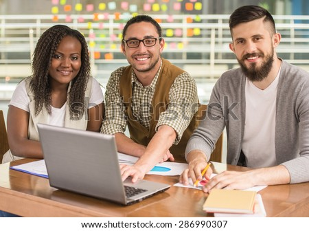 Young talented man showing to his business partners new project. - stock photo