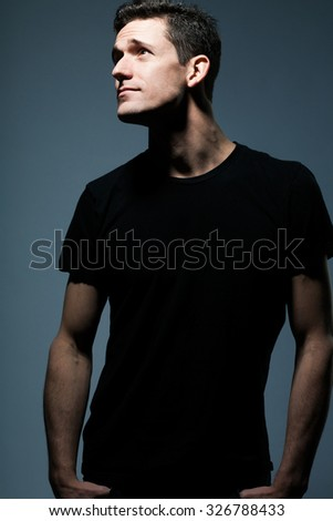Young tall man in black shirt. - stock photo