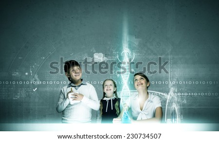 Young teacher and school children at chemistry lesson - stock photo