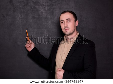 young teacher on chalkboard  background - stock photo