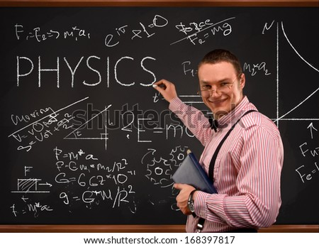 Young  teacher portrait with blackboard background (physics) - stock photo