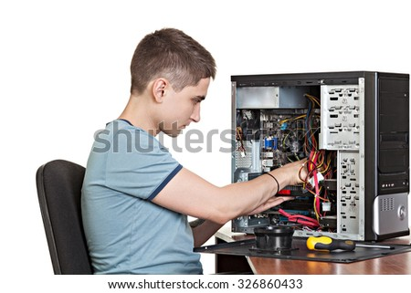 Young  technician repair  assembles computer. Studio shot. Image isolated on a white background. - stock photo