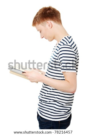 Young teen man is reading a book , isolated on white background - stock photo